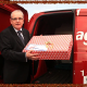 Jerry co-director of Eagle Couriers, a Courier Scotland company, putting present in van