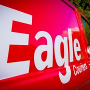 The distinctive logo and red vans of Eagle Couriers